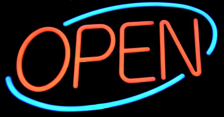 picture of a neon sign that says open